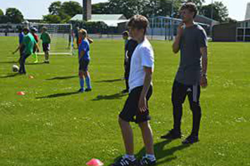 Reading footballer and ex-pupil John Swift visits Brune Park